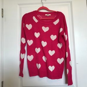 Hot pink sweater with white hearts